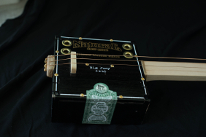 big jucy cigar box guitar photo