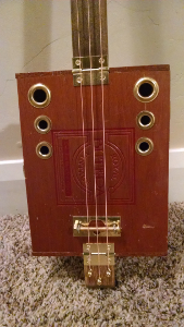 butera cigar box guitar photo