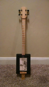 decade cigar box guitar photo